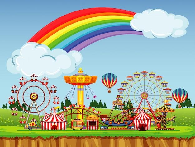 Circusscène met regenboog aan de hemel