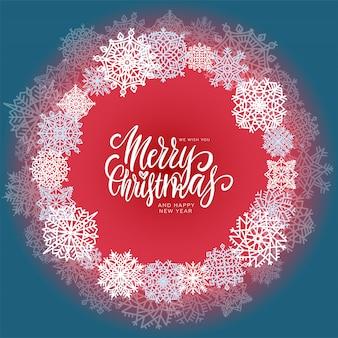 Cirkelsamenstelling met sneeuwvlokken en hand geschreven tekst vrolijke kerstmis.