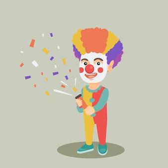 Clownjongen die een confetti van de partijpopper schieten.