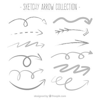 Collectie van decoratieve schetsmatig pijlen
