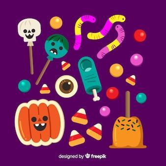Collectie van halloween snoep op platte ontwerp