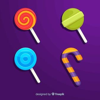 Collectie van halloween snoepjes op platte ontwerp