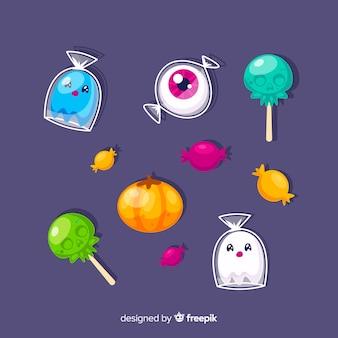 Collectie van hallween snoepjes op platte ontwerp