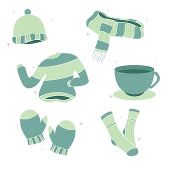 Collectie van winterkleren hand getrokken