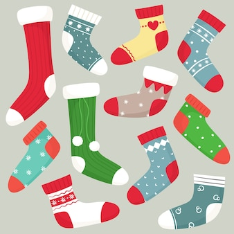 Collectie wintersokken. kerst sokken. vlakke geïsoleerde vectoren.