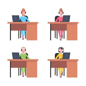 Collega's in headset instellen vrouwen operators zittend op de werkplek bureaus callcenter concept co-working open ruimte vrouwelijke kantoorpersoneel collectie volledige lengte witte achtergrond