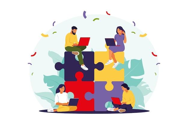 Commercieel team dat puzzel samenstelt