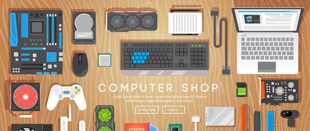 Computerwinkel. er liggen verschillende computeronderdelen op tafel.