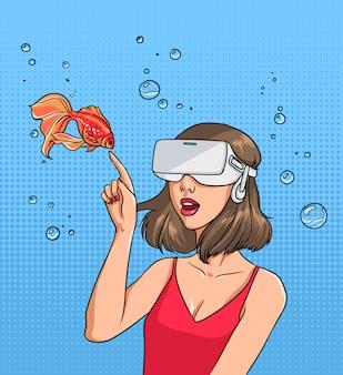Concept van virtuele realiteit. meisje in 3d-bril en goudvis. kleurrijke strips illustratie in pop-art stijl.