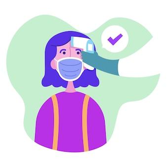Controleer de temperatuur van de vrouw die een masker draagt