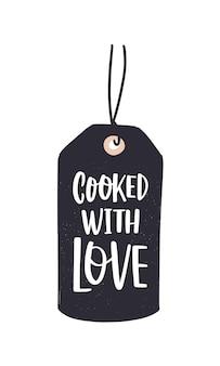 Cooked with love-inscriptie geschreven met cursief kalligrafisch lettertype of script op label of tag