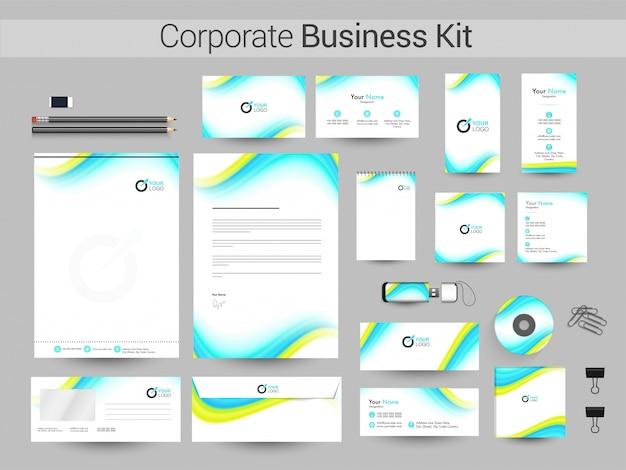 Corporate business kit met groene en luchtblauwe golven.