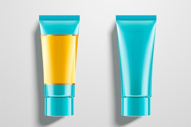 Cosmetische blauwe buizen ingesteld op lichtgrijze achtergrond