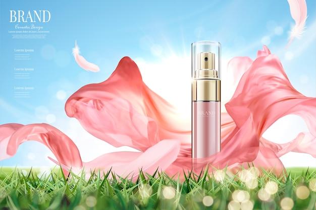 Cosmetische spray-advertenties met vliegende roze chiffon, product op grasland en heldere blauwe hemelachtergrond