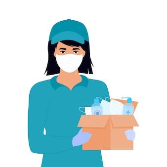 Covid-19. humanitaire hulp. levering van medische beschermingsmaskers en ontsmettingsmiddelen. corona-epidemie. bezorgmeisje dat pakket levert.