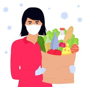 Covid19. corona-epidemie. het vrijwilligersmeisje houdt een pakket met voedsel. bezorgservice.