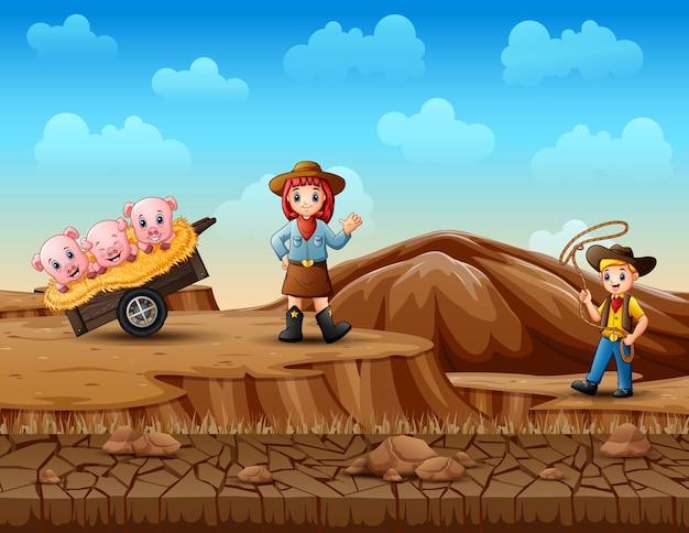 Cowboy en veedrijfster die varkens in de woestijn hoeden
