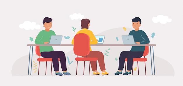 Coworking studio met mensen die aan de tafel zitten.