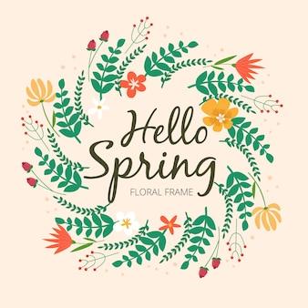 Creatief bloemenframe met hallo lente het van letters voorzien