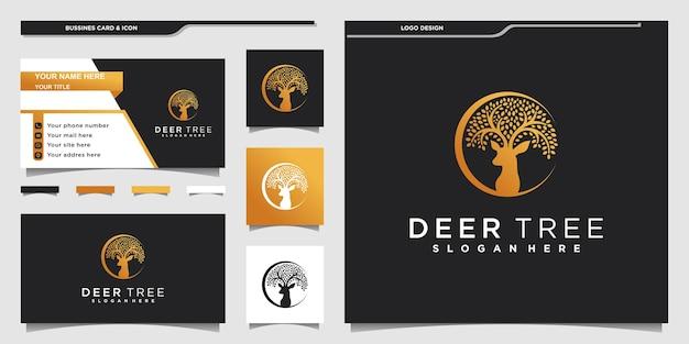 Creatief hertenboom-logo-ontwerp met een combinatie van bladeren en hertendieren en visitekaartjeontwerp premium vekto