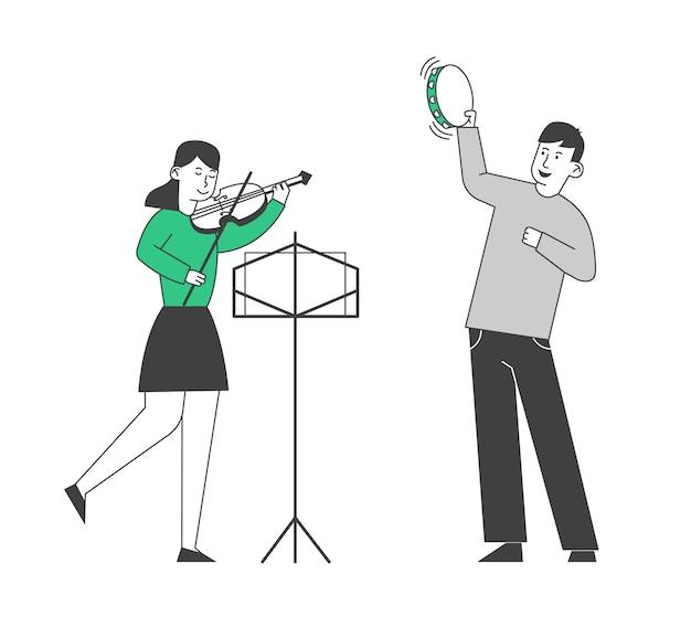 Creatief muzikaal duet van jongen die op tamboerijn speelt