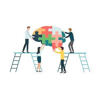 Creatieve groepswerkgroep mensen die een hersenenfiguurzaag voor het concept van de ziekte van alzheimer assembleren.