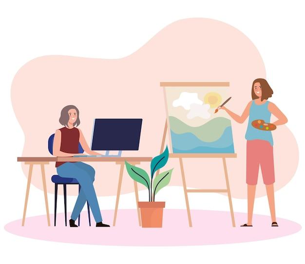 Creatieve jonge vrouwen die computer gebruiken en afbeeldingspersonages schilderen