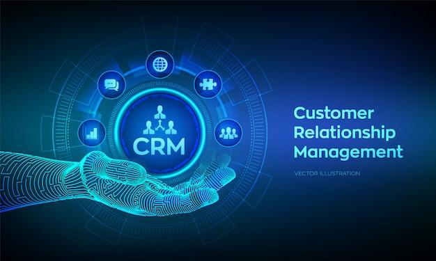 Crm-pictogram in robotic hand. beheer van klantrelaties. klantenservice en relatieconcept op virtueel scherm.