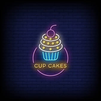 Cup cakes neonreclames op donkere muur