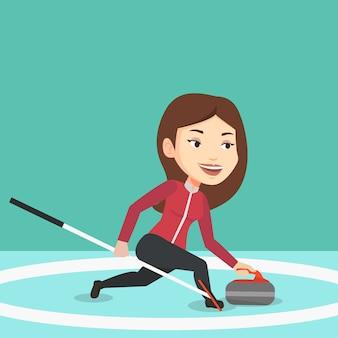 Curling speler speelt op de ijsbaan.