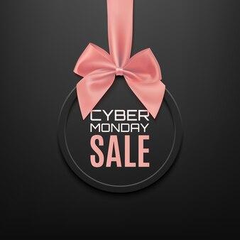 Cyber maandag te koop ronde banner met roze lint en boog, op zwarte achtergrond. brochure of banner sjabloon.