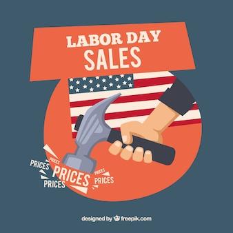 Dag van de arbeid verkoop achtergrond met hamer