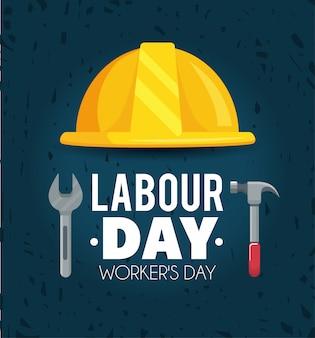 Dag van de arbeid vieren met helm en hamer