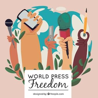 Dag van de persvrijheid achtergrond van handen met objecten