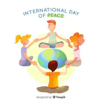 Dag van de vrede met kinderen hand in hand rond het woord