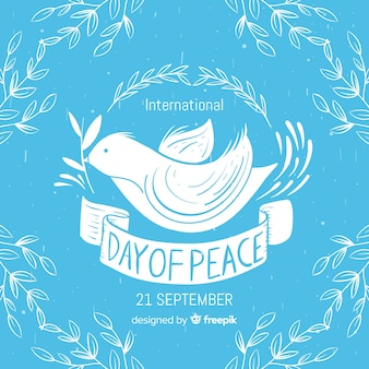 Dag van vredessamenstelling met hand getrokken witte duif