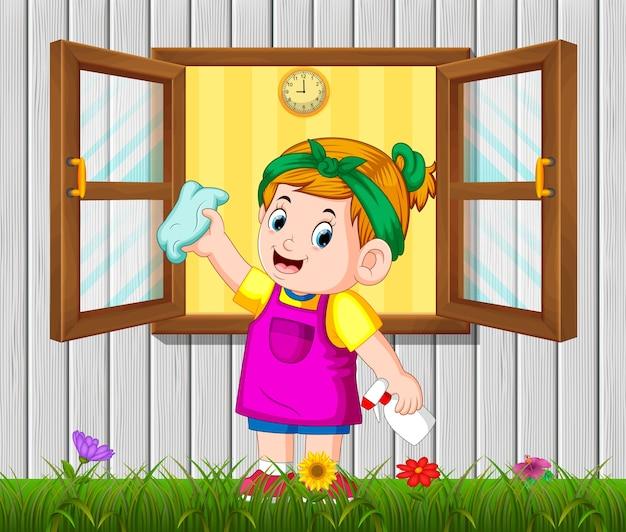 Dagelijks activiteitenmeisje dat het raam in de ochtend schoonmaakt
