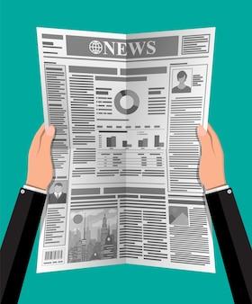 Dagelijkse krant in handen. nieuwsjournaal
