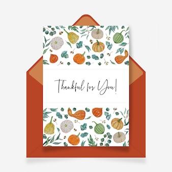 Dankbare wenskaart kaart met pompoen en groene bladeren