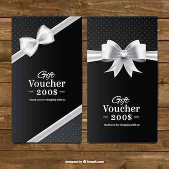 Dark gift coupons met een zilveren boog
