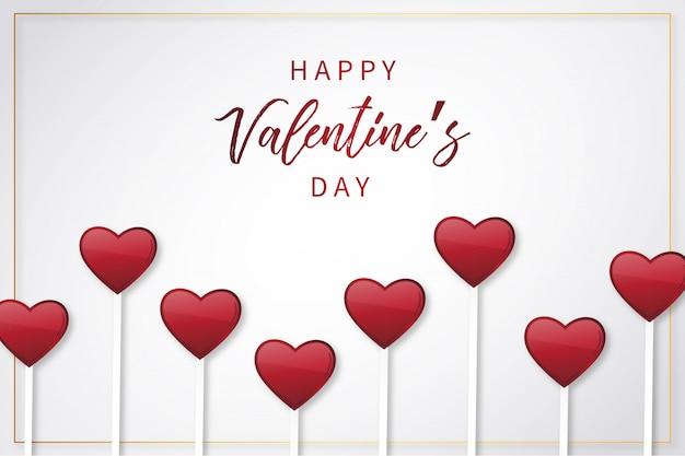 De achtergrond van de gelukkige valentijnskaart met lollysharten