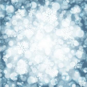 De achtergrond van de kerstmiswinter met magische sneeuw schittert lichten en sneeuwvlokken