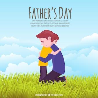 De achtergrond van de vadersdag met papa die zoon koestert
