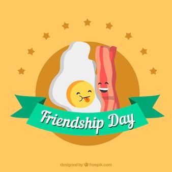 De achtergrond van de vriendschapsdag met ei en bacon