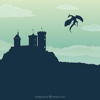 De achtergrond van het kasteelsilhouet met draak het vliegen