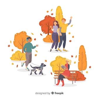 De artistieke karakters groeperen de herfst in park