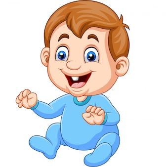 De babyjongen die van het beeldverhaal blauwe pyjama draagt