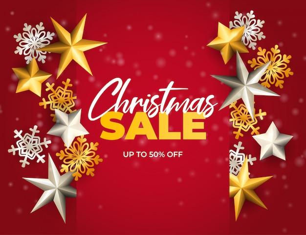 De banner van de kerstmisverkoop met sterren en vlokken op rode grond