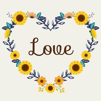 De bloemenkrans in hartvorm met zonnebloem en liefdetekst.