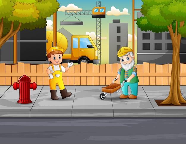 De bouwers werken op de bouwplaats
